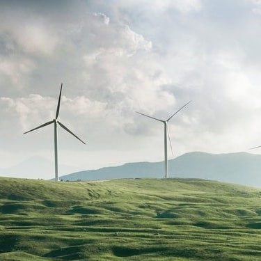 Windmills with mountains in the background